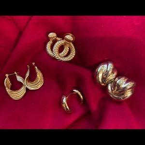 Bundle of gold pierced earrings.